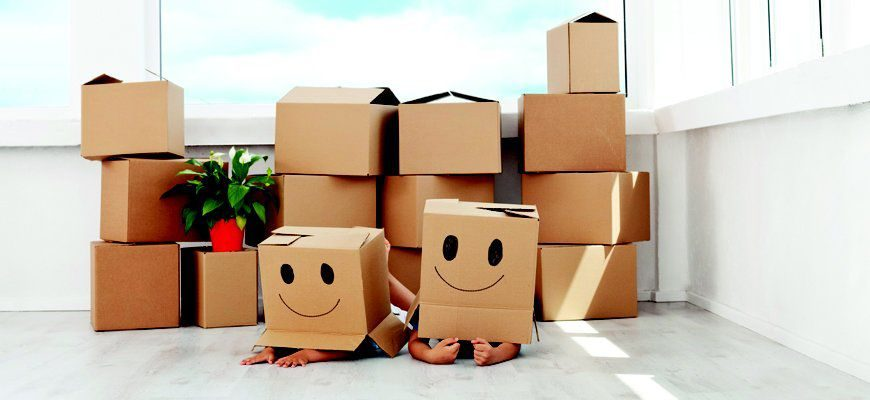 Packing boxes with a smile demonstrate the positive experience our local movers NJ aim to provide.