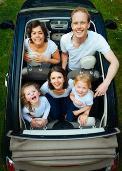 family in a car, moving to one of the best places for families in Bergen County