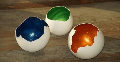 three multicolored empty egg shells