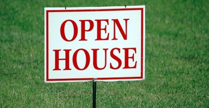"a sign that says ""open house"""