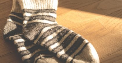 a pair of stripped gray socks