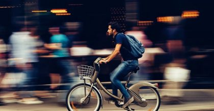 a man riding a bike in a hurry to get to the gym