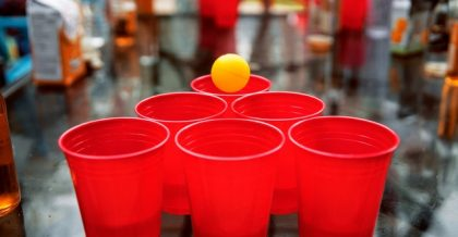 a set of beer pong cups and a ball